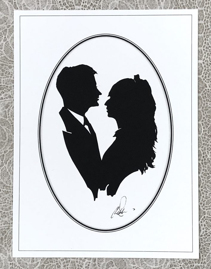 A couple facing each other in silhouette