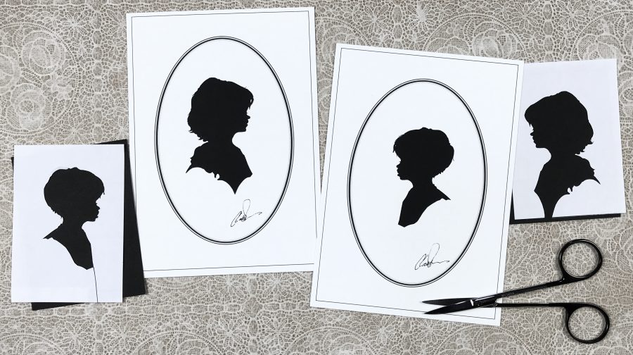Silhouettes of a boy and girl together with off-cuts & scissors