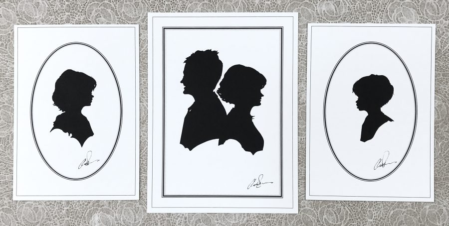Family group of three silhouettes