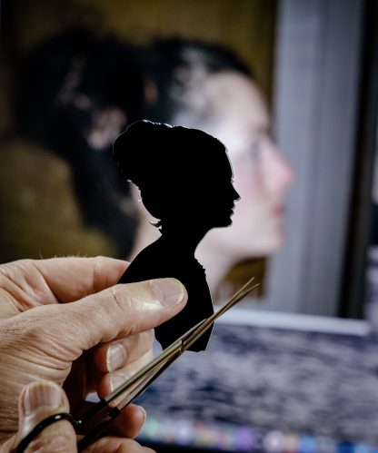 Holding up a silhouette to judge the likeness