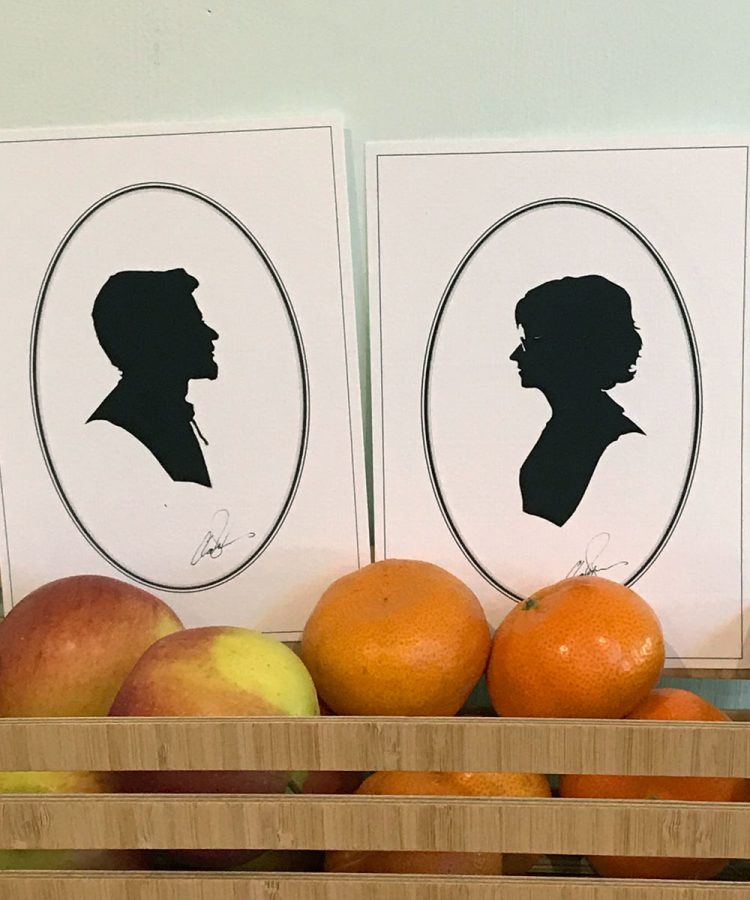 Two silhouettes in a bowl of fruit