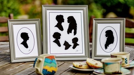 Three grey frames with seven silhouettes on a tea table